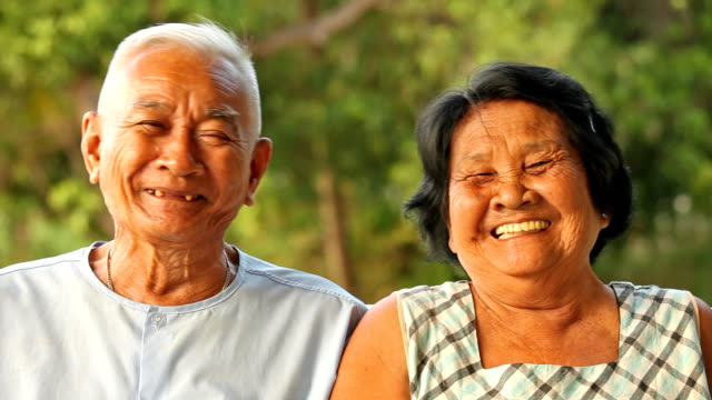 happy asian senior couple - thai ethnicity stock videos & royalty-free footage