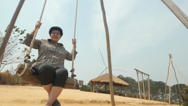 happy asian senior woman adult  swinging - swinging stock videos & royalty-free footage