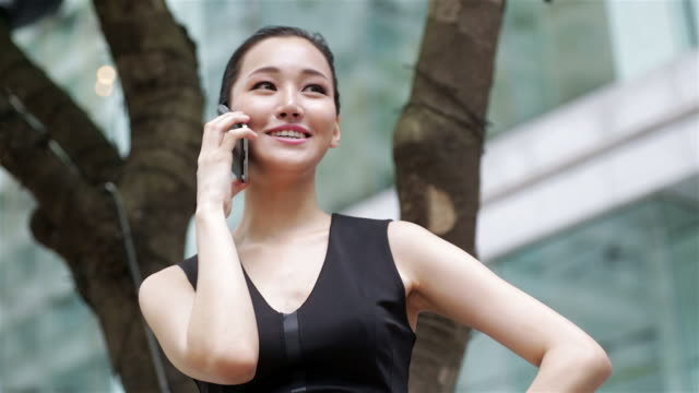Happy Asian Woman on the Phone