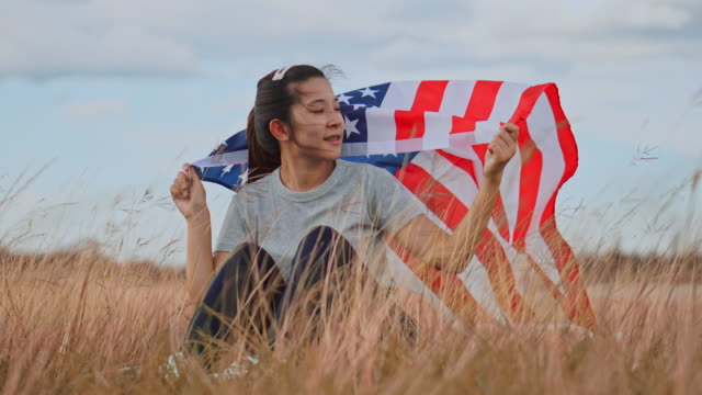 happy asian woman with american flag usa celebrate 4th of july - july stock videos & royalty-free footage