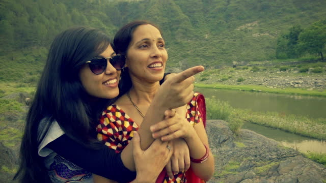 happy asian young woman with her mother in hills. - indian subcontinent ethnicity stock videos and b-roll footage