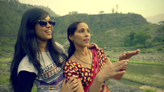happy asian young woman with her mother in hills. - indian mom stock videos & royalty-free footage