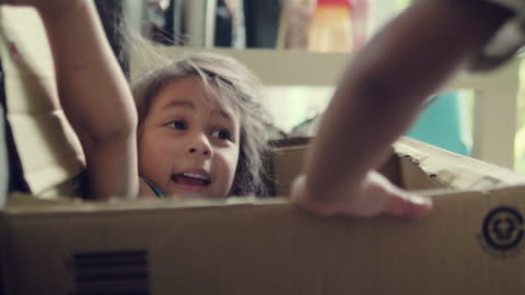 happy baby and her sister playing in cardboard box. - art and craft stock videos & royalty-free footage