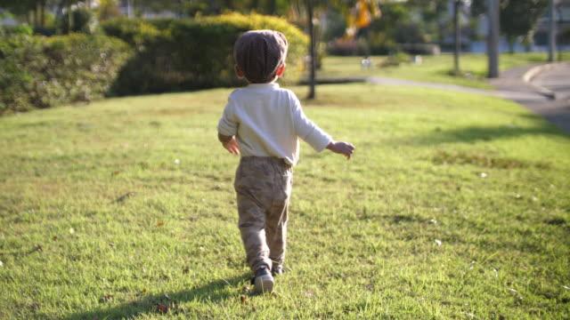 Happy baby boy enjoy walking in the park
