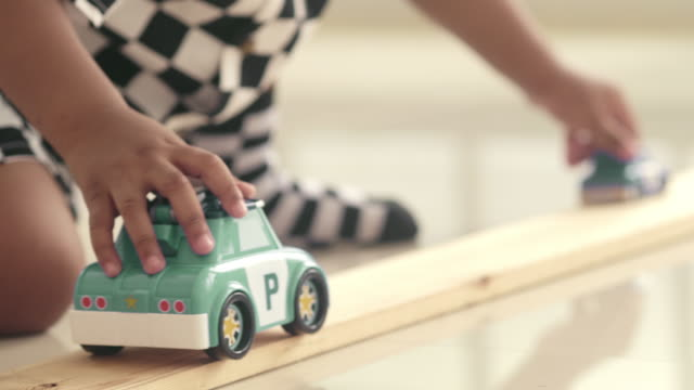 happy baby boy playing toy car - toddler stock videos & royalty-free footage