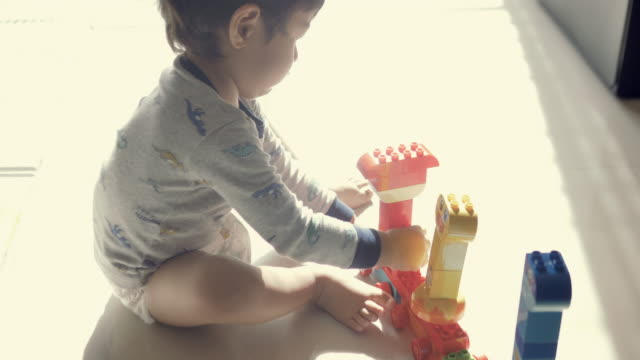 happy baby boy playing with blocks - nappy stock videos & royalty-free footage