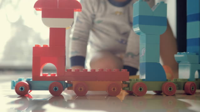 happy baby boy playing with blocks - diaper stock videos & royalty-free footage