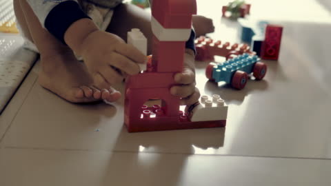happy baby boy playing with blocks - toddler stock videos & royalty-free footage