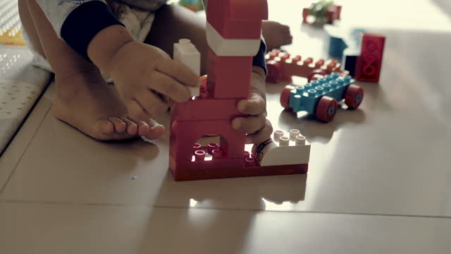 happy baby boy playing with blocks - toy block stock videos and b-roll footage