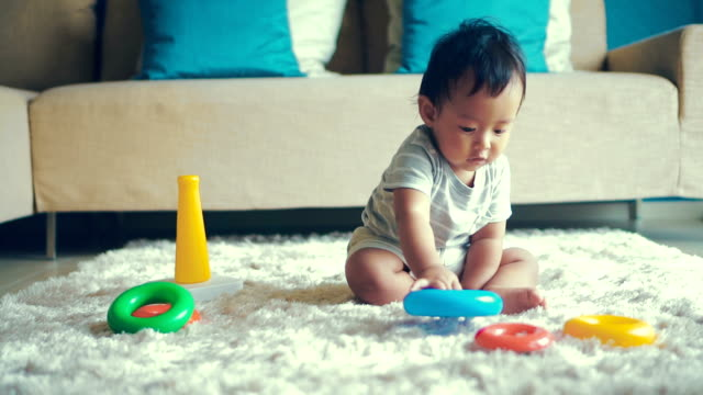 happy baby boy playing with blocks - flooring stock videos & royalty-free footage