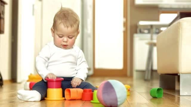 happy baby girl playing with blocks - one baby girl only stock videos & royalty-free footage
