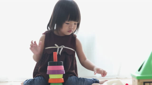 happy baby girl playing with blocks - only girls stock videos & royalty-free footage