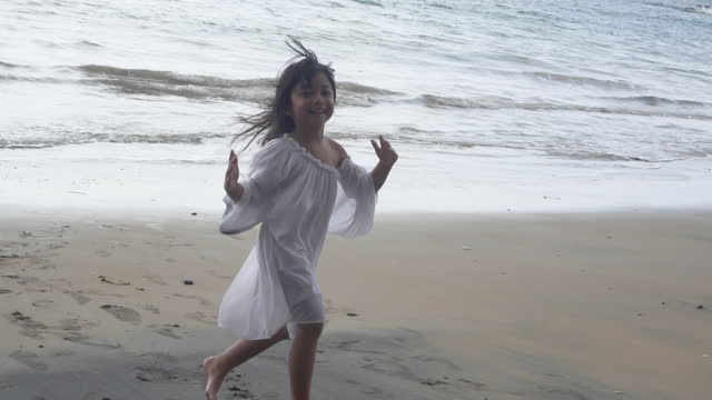 happy baby girl relaxing on the beach. - white dress stock videos & royalty-free footage