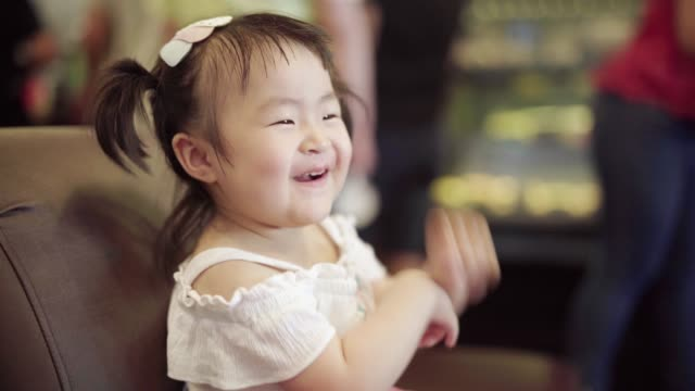 happy baby girl sitting on sofa - only baby girls stock videos & royalty-free footage