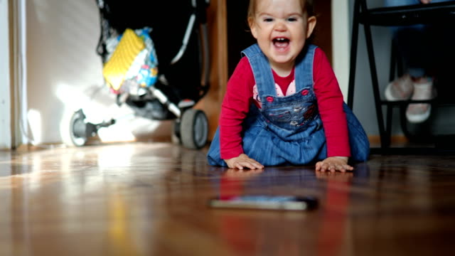 happy baby reaching smart phone - babies only stock videos & royalty-free footage