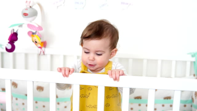 happy baby standing in bed - one baby girl only stock videos & royalty-free footage