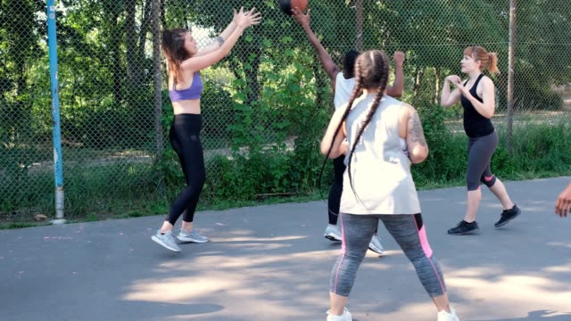 happy basketball team cheering on court - team sport stock videos & royalty-free footage