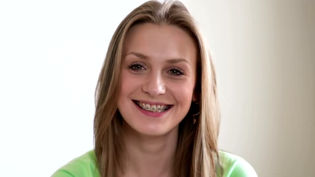 happy beautiful girl with braces - brace stock videos and b-roll footage