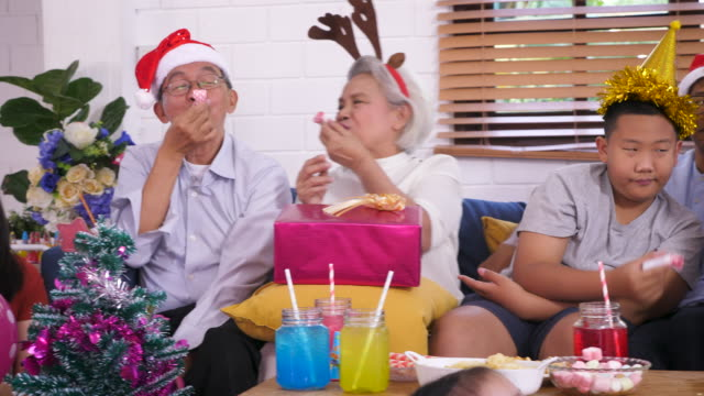 happy big asian family enjoy celebrate christmas together in living room at home, multi-genneration family concept - 6 11 months stock videos & royalty-free footage
