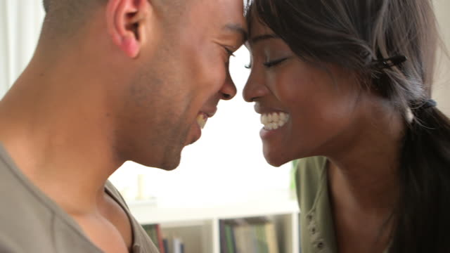 Happy black couple laughing
