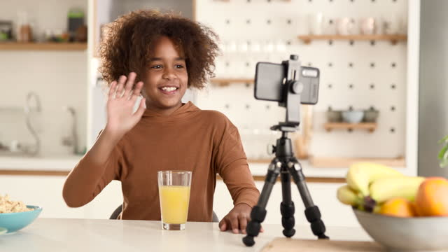 happy black girl vlogging over cell phone from home. - live broadcast stock videos & royalty-free footage