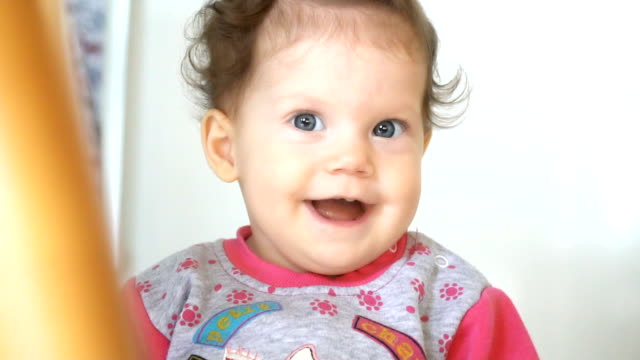 happy blond baby laughing - video ritratto video stock e b–roll