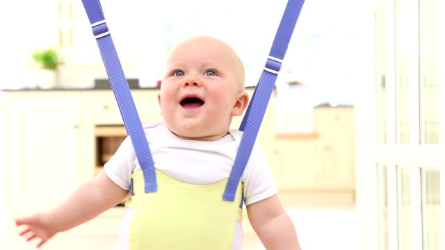 happy bouncing baby - baby waving stock videos & royalty-free footage