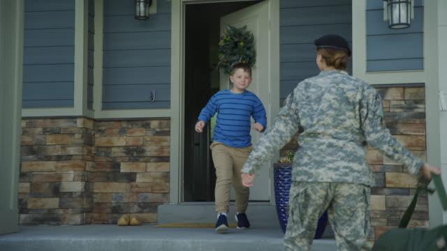 vídeos y material grabado en eventos de stock de happy boy greeting soldier mother returning home from duty / lehi, utah, united states - lehi