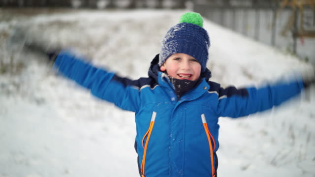happy boy in snow - cap hat stock videos & royalty-free footage