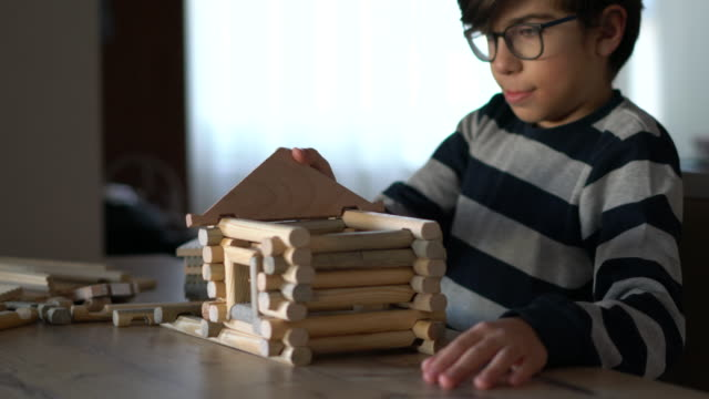 happy  boy playing  with wood house - craft stock videos & royalty-free footage