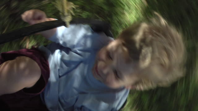 SLO MO CU HA Happy boy (2-3) spinning around in swing, Cape Town, South Africa