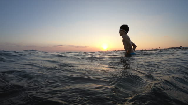 happy boy swimming on the sea - sottomarino subacqueo video stock e b–roll