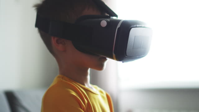 happy boy  using vr headset virtual reality simulator, looking around - cyberspace stock videos & royalty-free footage