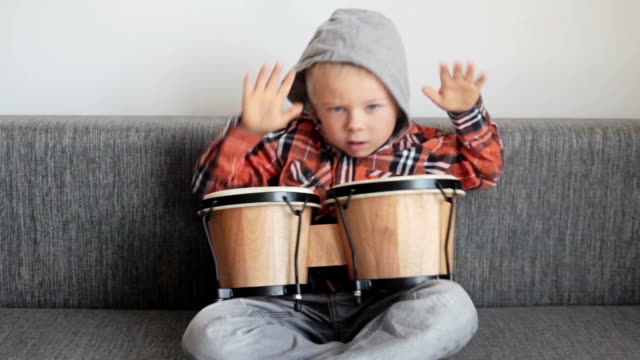 Happy boy with bongos