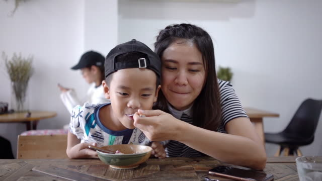 happy boy with mother eating homemade ice cream. - cream stock videos and b-roll footage