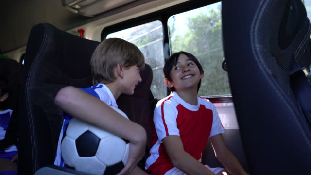 happy boys in a bus on their way to summer football camp talking - south america stock videos & royalty-free footage
