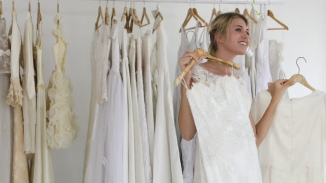 happy bride and groom in wedding dress prepare and searching for that special dress for married in wedding ceremony. - choice stock videos & royalty-free footage