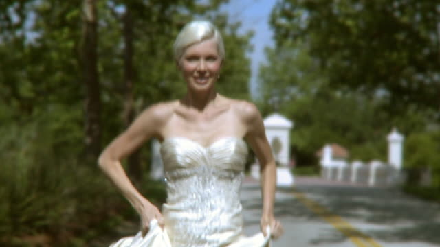 SLO MO CU DS Happy bride in wedding dress running in park, Jacksonville, Florida, USA