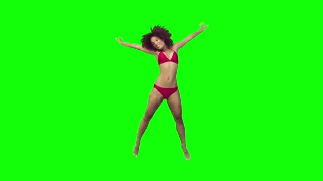 Happy brunette jumping in slow motion