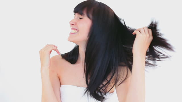 happy brunette woman touching her hair - bangs stock videos and b-roll footage