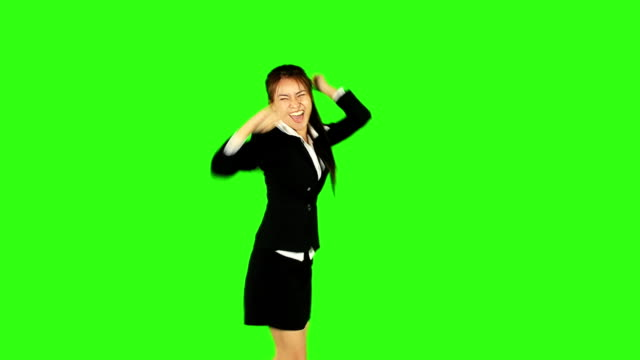 stockvideo's en b-roll-footage met happy business woman dancing with green screen background - keyable