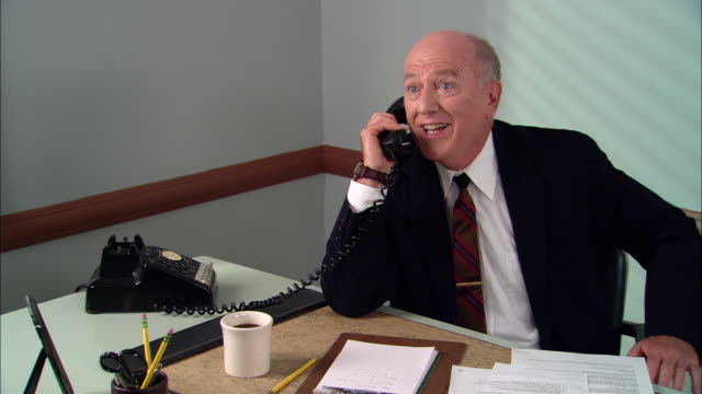 ms happy businessman in office on phone call/ man hanging up phone, giving thumbs up and drinking coffee/ new york city - hanging up stock videos and b-roll footage