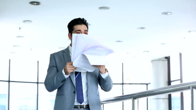 ms happy businessman throwing papers in air in office - dokument stock-videos und b-roll-filmmaterial