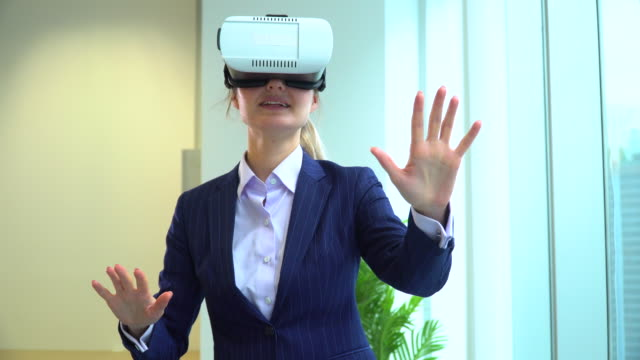 happy businesswoman using vr glasses in office - 25 29 years stock videos & royalty-free footage