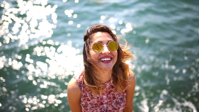 happy by the sea - sonnenbrille stock-videos und b-roll-filmmaterial