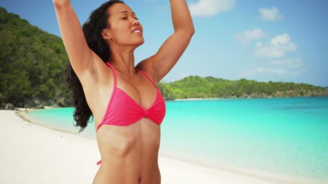 vídeos y material grabado en eventos de stock de happy carefree woman feeling the breeze while on tropical vacation - filipino
