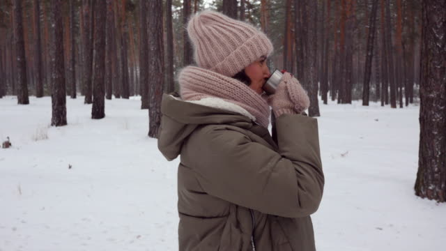 happy caucasian lady marching in the forest in winter - mitten stock videos and b-roll footage