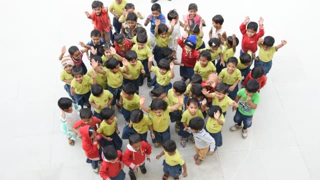 happy cheerful kids playing at their school, india. - small stock videos & royalty-free footage