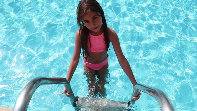 happy child girl enjoying in the pool - one girl only stock videos & royalty-free footage