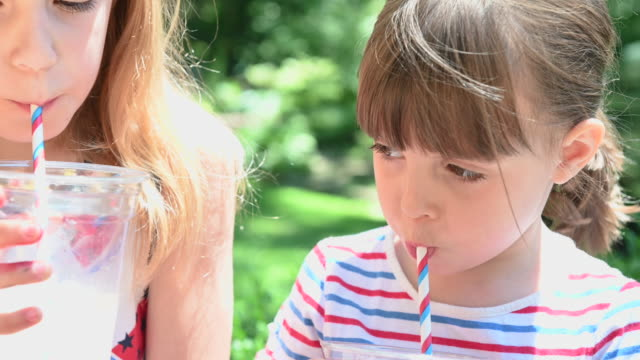 happy children drinking lemonade during summer - paglia video stock e b–roll
